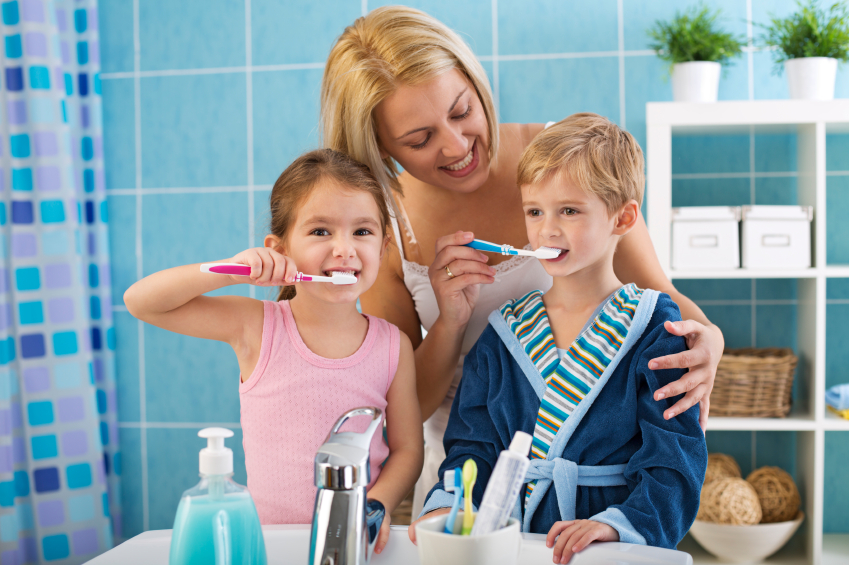 mom-brushing-kids-teeth